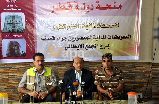 Palestinian Minister of public works and housing, Mufid al-Hasayna speaks during a press conference in Gaza City. September 6, 2014. Photo by Mohammed Talatene