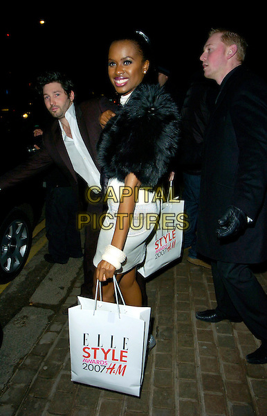 JUNE SARPONG.Leaving the ELLE Style Awards, The Roundhouse, Chalk Farm Road, London, UK..February 12th 2007.full length black dress white fur jacket goody bag bracelets bangles .CAP/CAN.©Can Nguyen/Capital Pictures