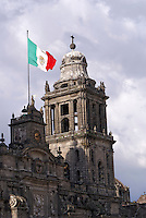 Mexican flag flying over the Metropolitan Cathedral in downtown Mexico City