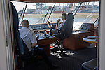 Captain and staff on the bridge of a Spido tour boat in the Port of Rotterdam, Netherlands
