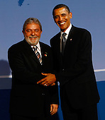 Pittsburgh, PA - September 24, 2009 -- United States President Barack Obama (R) welcomes Brazilian President Luiz Inacio Lula da Silva to the welcoming dinner for G-20 leaders at the Phipps Conservatory on Thursday, September 24, 2009 in Pittsburgh, Pennsylvania. Heads of state from the world's leading economic powers arrived today for the two-day G-20 summit held at the David L. Lawrence Convention Center aimed at promoting economic growth.  .Credit: Win McNamee / Pool via CNP