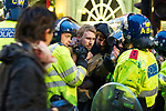 """© Joel Goodman - 07973 332324 . 26/03/2011 . London , UK . Police detain UK Uncut protesters who have occupied Fortnum and Mason in Piccadilly . Hundreds of thousands of people attend an anti cuts demonstration under the banner """" March for the Alternative """" in central London , in protest at the coalition government's austerity measures . Photo credit : Joel Goodman"""