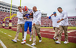 /An injured Florida wide receiver Tyrie Cleveland (89) is led from the field in the 2nd half of an NCAA college football game against Florida State in Tallahassee, Fla., Saturday, Nov. 24, 2018. Florida defeated Florida State 41-14. (AP Photo/Mark Wallheiser)