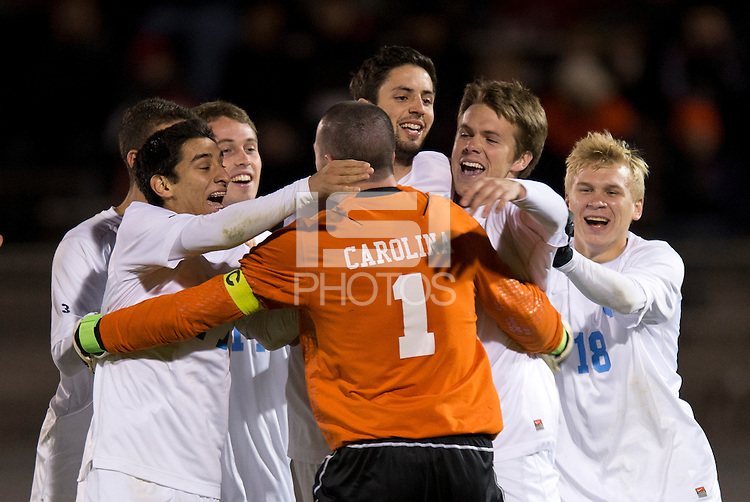 Scott Goodwin (1) of North Carolina is surrounded by teammates in celebration after the game at the Maryland SoccerPlex in Germantown, MD. North Carolina defeated Virginia on penalty kicks after playing to a 0-0 tie in regulation time.  With the win the Tarheels advanced to the finals of the ACC men's soccer tournament.
