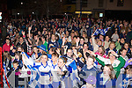 Desmonds players celebrate at the team homecoming on Saturday night