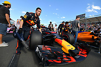 March 25, 2018: Mechanics wheel the car of Max Verstappen (NLD) #33 from the Aston Martin Red Bull Racing team on the grid prior to the start of the 2018 Australian Formula One Grand Prix at Albert Park, Melbourne, Australia. Photo Sydney Low