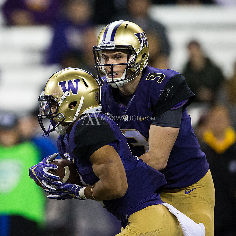 Jake Browning hands off to Myles Gaskin.
