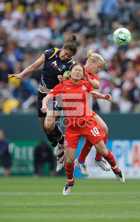 Los Angeles Sol (7) Shannon Boxx and Washington Freedom Lori Lindsey, (6) and Homare Sawa (10)battle for a ball during a game at the Home Depot Center in Carson, CA on Sunday, March 29, 2009..