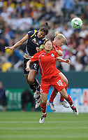 Los Angeles Sol (7) Shannon Boxx and Washington Freedom Lori Lindsey, (6) and Homare Sawa (10) battle for a ball during a game at the Home Depot Center in Carson, CA on Sunday, March 29, 2009..