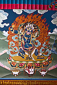 A popular Bhutanese painting of Vajrapani (in sanskrit) or Chanadorji (in Bhutanese) symbolizing energy and power seen at the Tashichhodzong (fortress of auspicious religion) in the capital city Thimphu, Bhutan. Photo: Sanjit Das/Panos