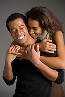 Young Hispanic couple embracing