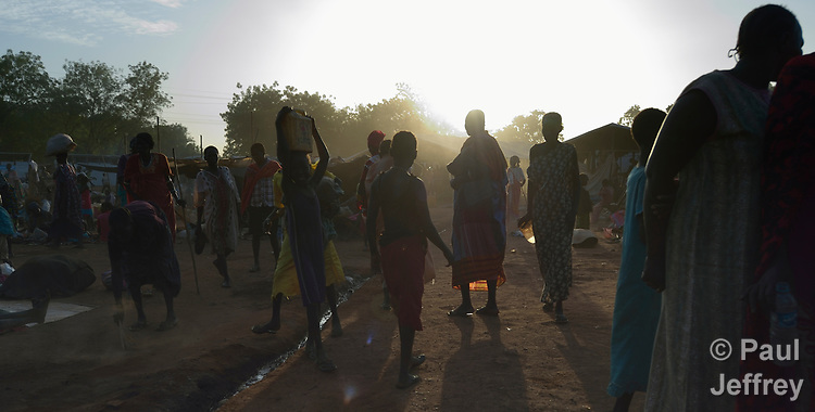 Morning in a camp for over 5,000 internally displaced persons in an Episcopal Church compound in Wau, South Sudan. Most of the families here were displaced by violence early in 2017, after a larger number took refuge in other church sites when widespread armed conflict engulfed Wau in June 2016.<br /> <br /> Norwegian Church Aid, a member of the ACT Alliance, has provided relief supplies to the displaced in Wau, and has supported the South Sudan Council of Churches as it has struggled to mediate the conflict in Wau.