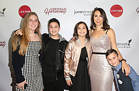 """LOS ANGELES, CA - NOVEMBER 7: Claudia Schwarz, Grayson Schwarz, Aden Schwarz, Noey Schwarz and Jude Schwarz, at Premiere of Lifetime's """"Christmas Harmony"""" at Harmony Gold Theatre in Los Angeles, California on November 7, 2018. Credit: Faye Sadou/MediaPunch"""