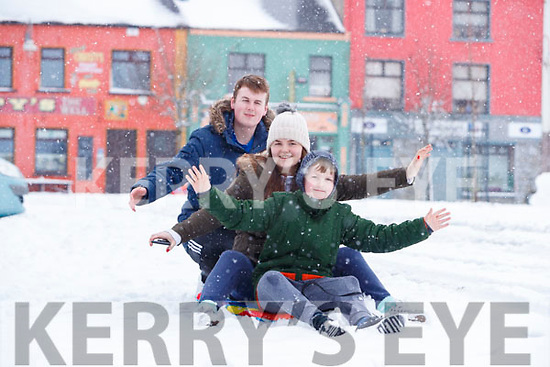 Barry, Tracey and Sean Kelliher,  enjoying the snow in Listowel on Friday.