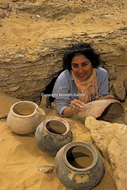 Salima Ikram removes vessels from escarpment near Ain Dabashiya, Darb el-Arbaein, trade route, Egypt; Ancient Cultures; Archaeologist; Salima Ikram; Kharga Oasis; Desert; oasis