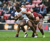 Huddersfield Giants' Jermaine McGillvary is tackled by Wigan Warriors' Willie Isa and George Williams <br /> <br /> Photographer Stephen White/CameraSport<br /> <br /> Betfred Super League Round 5 - Wigan Warriors v Huddersfield Giants - Sunday 19th March 2017 - DW Stadium - Wigan<br /> <br /> World Copyright &copy; 2017 CameraSport. All rights reserved. 43 Linden Ave. Countesthorpe. Leicester. England. LE8 5PG - Tel: +44 (0) 116 277 4147 - admin@camerasport.com - www.camerasport.com