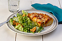 Pepperoni cheese pizza slice with side salad