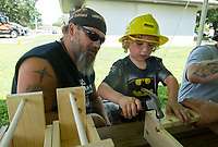 NWA Democrat-Gazette/BEN GOFF @NWABENGOFF<br /> Jason Carr helps his grandson Evan Harvey, 5, both of Gentry, make a tool box, a children's activity set up by Meek's, Thursday, July 4, 2019, during the 125th annual Gentry Freedom Fest at Gentry City Park.