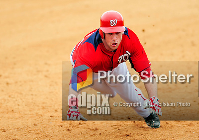 1 March 2011: Washington Nationals' outfielder Corey Brown slides safely into third during a Spring Training game against the New York Mets at Space Coast Stadium in Viera, Florida. The Nationals defeated the Mets 5-3 in Grapefruit League action. Mandatory Credit: Ed Wolfstein Photo