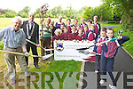 Pupils from Scoil Réalt na Maidne in Listowel who planted trees in Listowel Town Park as part of the local Tidy Towns effort pictured here with Kieran Moloney (Listowel Tidy Towns), Cllr Tom Barry (Mayor of Listowel), Margaret Coffey, and teachers Catherine McEllistrim and Ellie Hellard.