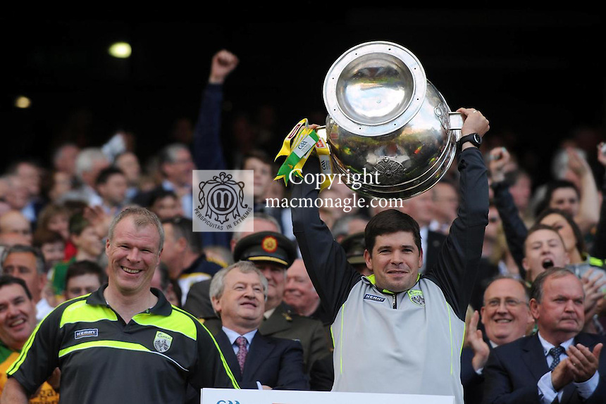 Eamonn Fitzmaurice and Diarmuid Murphy lifts the Sam Maguire Cup to celebrate  Kerry's victory over Donegal in the All-Ireland Football Final against  in Croke Park 2014.<br /> Photo: Don MacMonagle<br /> <br /> <br /> Photo: Don MacMonagle <br /> e: info@macmonagle.com