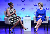 "First lady Michelle Obama and former first lady Laura Bush participate in a conversation on ""Investing in our Future at the U.S. - Africa Leaders Summit at the John F. Kennedy Center for the Performing Arts in Washington, D.C. on Wednesday, August 6, 2014.<br /> Credit: Ron Sachs / Pool via CNP"