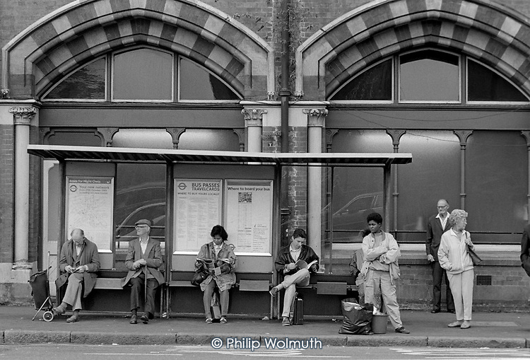 Bus queue, Pancras Road, Kings Cross, London 1990.