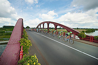 Belkin Boys leading over the bridge defending Mark Renshaws GC lead<br /> <br /> Eneco Tour 2013<br /> stage 2: Ardooie - Vorst (Brussel)<br /> 177km