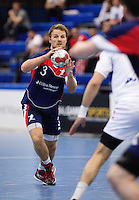 06 APR 2012 - LONDON, GBR - Great Britain's Ciaran Williams (GBR) (left, #3, in blue and red) prepares to pass during the men's 2012 London Cup match against Tunisia at the National Sports Centre in Crystal Palace, Great Britain (PHOTO (C) 2012 NIGEL FARROW)