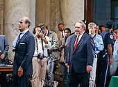 Judge Robert H. Bork, United States President Ronald Reagan's nominee for Associate Justice of the U.S. Supreme Court, is led into the hearing room past photographers by U.S. Senate Judiciary Committee Chairman Joseph Biden (Democrat of Delaware) prior to his giving tratimony at his confirmation hearing on September 15, 1987.  Bork passed away on December 19, 2012..Credit: Arnie Sachs / CNP