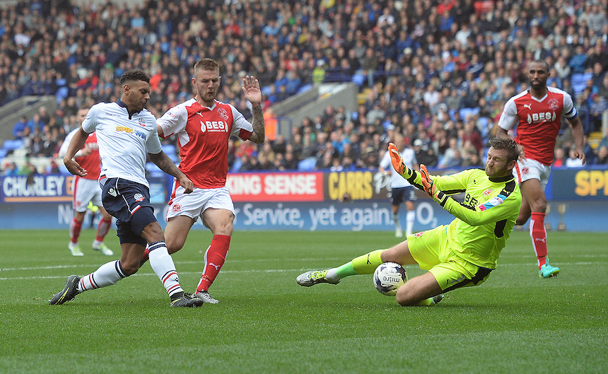 Bolton Wanderers's Kaiyne Woolery sees his shot saved by Fleetwood Town's Chris Neal<br /> <br /> Photographer Ian Cook/CameraSport<br /> <br /> Football - The EFL Sky Bet League One - Bolton Wanderers v Fleetwood Town - Saturday 20 August 2016 - Macron Stadium - Bolton<br /> <br /> World Copyright &copy; 2016 CameraSport. All rights reserved. 43 Linden Ave. Countesthorpe. Leicester. England. LE8 5PG - Tel: +44 (0) 116 277 4147 - admin@camerasport.com - www.camerasport.com