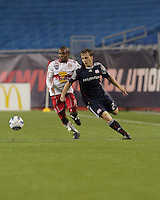 New England Revolution defender Seth Sinovic (27) and New York Red Bulls forward Dane Richards (19) battle for loose ball. The New England Revolution defeated the New York Red Bulls, 3-2, at Gillette Stadium on May 29, 2010.