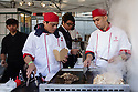 Two men cook food on a stall at the 10th Japanese Matsuri Festival, Trafalgar Square, London.