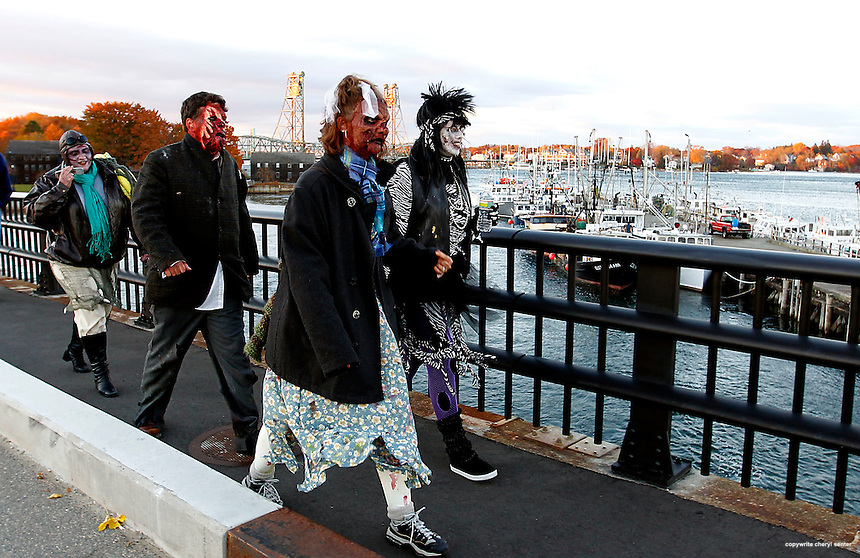 Zombies from left, Jennifer Cicchetto-Tuthill of Rochester, Brian and Jaie Eibert of Dover and Kathy Jackson of Rochester head to Pierce Island to prepare for the Portsmouth Halloween Parade in Portsmouth, N.H. Sunday, Oct. 31,  2010.  (Portsmouth Herald Photo Cheryl Senter)