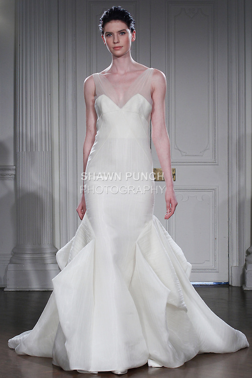 "Model walks runway in a bridal gown from the Peter Langner Spring Summer 2015 ""Concert in White"" bridal collection, during New York Bridal Fashion Week, on April 12, 2014."