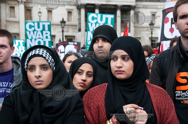 Young Muslim women attending a rally in London's Trafalgar Square organised by the Stop the War Coalition to mark 10 years of war in Afghanistan.