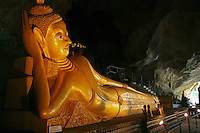 "Reclining Buddha at Wat Tham Suwankuha, a 100-year-old temple hidden inside a cave housing various images of Buddha, including this reclining one.  Wat Tham Suwankuha is also known as Wat Tam, Wat Tham and ""the monkey temple"" fpr its large population of macaque monkeys."