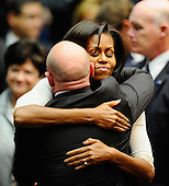 "First lady Michelle Obama (R) hugs NASA astronaut Mark Kelly, husband of U.S. Representative Gabrielle Giffords (Democrat of Arizona), at the event ""Together We Thrive: Tucson and America"" honoring the January 8 shooting victims at McKale Memorial Center on the University of Arizona campus on Wednesday, January 12, 2011 in Tucson, Arizona. The memorial service is in honor of victims of the mass shooting at a Safeway grocery store that killed six and injured at least 13 others, including U.S. Representative Gabrielle Giffords (Democrat of Arizona), who remains in critical condition after being shot in the head. Among those killed were U.S. District Judge John Roll, 63; Giffords' director of community outreach, Gabe Zimmerman, 30; and 9-year-old Christina Taylor Green. .Credit: Kevork Djansezian / Pool via CNP"