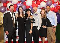 NWA Democrat-Gazette/CARIN SCHOPPMEYER Nate and Monica Sweeney (from left), Tessa Dalton and Margo White help support March of Dimes at the Signature Chef Auction on Oct. 10 at the Scott Family Amazeum in Bentonville.