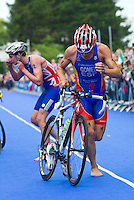 04 JUL 2010 - ATHLONE, IRL - Javier Gomez (ESP) is first away from his stand as Alistair Brownlee (GBR) puts on his bike helmet during T1 at the European Elite Mens Triathlon Championships .(PHOTO (C) NIGEL FARROW)