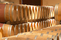 In the wine cellar, rows of new oak barrels with ageing wine Chateau Bouscaut Cru Classe Cadaujac Graves Pessac Leognan Bordeaux Gironde Aquitaine France