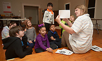 NWA Democrat-Gazette/ANDY SHUPE<br /> Instructor Heather Younger Morton (right) leads a group of students Wednesday, Jan. 3, 2018, in a discussion of what an ink blot painting resembles during BLACKOUT, a youth art camp at Artist's Laboratory Theatre in Fayetteville. The eight-day pay-what-you-can camp is exploring the affect of light and dark through art, performance and science experiments and runs through Friday.