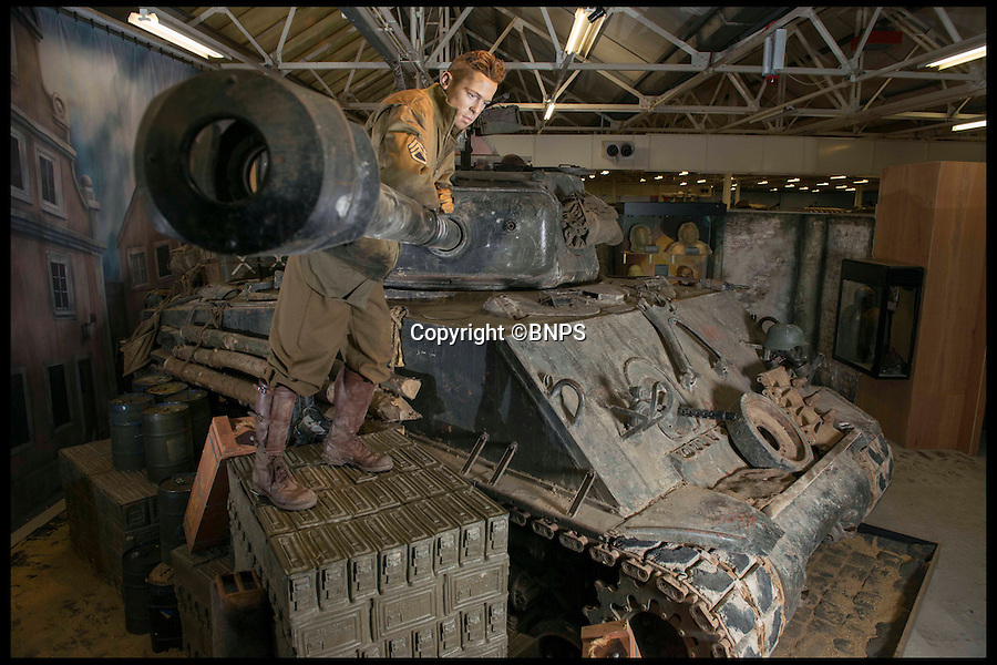 BNPS.co.uk (01202 558833)<br /> PIc: LauraDale/BNPS<br /> <br /> A model of actor Brad Pitt resting on the 'Fury' tank used in the Blockbuster film.<br /> <br /> Meet the real driving force behind Brad Pitt's new Second World War blockbuster, Fury.<br /> <br /> Tank mechanics Brian Frost, 39, and Ian 'Buzz' Aldridge, 53, were hired to drive the famous Sherman tank the movie is named after for most of the major scenes.<br /> <br /> The pair, who work at Bovington Tank Museum in Dorset, spent six months taking it in turns to operate the 26 ton tank in front of the cameras.<br /> <br /> Although the two never appear in the movie, every time 'Fury' is seen in motion and without actor Michael Pena in the driving seat,<br /> Brian or Buzz are at the controls.<br /> <br /> The pair also trained actor Pena the basics of driving the Sherrman tank to give the close-up shots of his character Corporal Trini 'Gordo' Garcia more legitimacy.<br /> <br /> The museum lent the movie's producers their M4 Sherman tank to act as Fury as well as the services of Brian and Buzz.