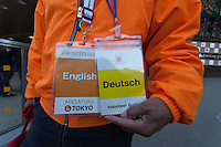 A volunteer tourist guide holds cards showing which languages he speaks in Shinjuku, Tokyo, Japan. Friday December 9th 2016. In preparation for the 2020 Tokyo Olympics and to aid the increasing number of tourists visiting the country tourists guides organised by the Tokyo Government volunteer to provide multi-lingual information at popular destinations around the capital