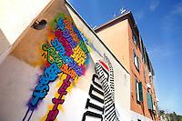 Il concetto resta estraneo per te se non hai il codice, Artista Daniele Tossi, in arte Pepsi<br /> Artist Pepsi<br /> Roma 01-02-2015 Street Art a Roma. In vari quartieri di Roma e' fiorita la Street Art, con splendidi murales che hanno lo scopo di raccontare delle storie della citta', di commemorare dei momenti importanti, o semplicemente di interpretarla.<br /> Street Art in Rome. Very important writers  painted Murales in various districts of Rome to tell stories about the city, to commemorate important moments, to embellish the quarter or simply to portray it.  <br /> Photo Samantha Zucchi Insidefoto