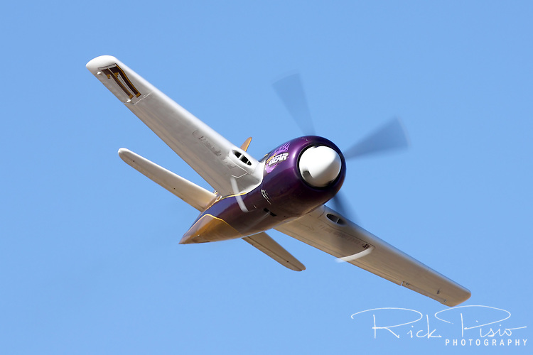 Rare Bear, piloted by John Penney, zooms through the Valley of Speed during the 2008 Reno Championship Air Races. Penney piloted the highly modified Grumman Bearcat during the Unlimited Gold Championship Race but did not finish due to a failure of the Pratt & Whitney R3500 engine.