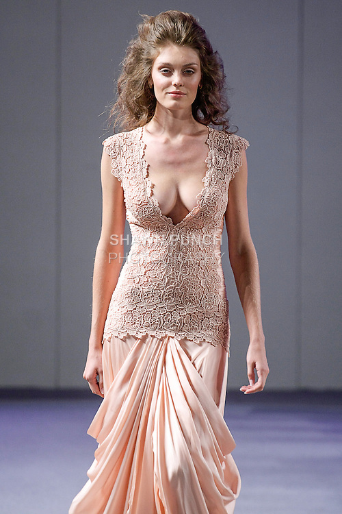 "Model walks runway in a bridal gown from Isabel Zapardiez ""Remembering"" collection, during Couture Fashion Week in New York City, September 15, 2012."