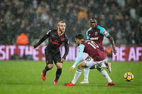Jack Wilshere of Arsenal as Michail Antonio of West Ham United looks on during the Premier League match between West Ham United and Arsenal at the Olympic Park, London, England on 13 December 2017. Photo by Andy Rowland.