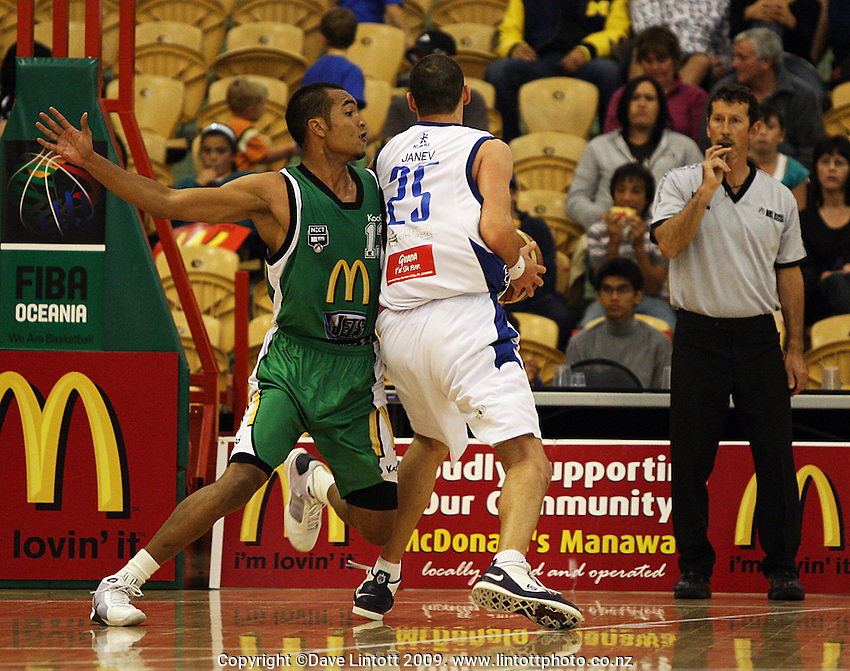 Manawatu's Marcel Jones fouls Blagoj Janev during the NBL Round 5 match between the Manawatu Jets  and Auckland Stars at Arena Manawatu, Palmerston North, New Zealand on Friday 10 April 2009. Photo: Dave Lintott / lintottphoto.co.nz