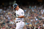 Seattle Mariners Kyle Seager looks at his bat before batting against the Oakland Athletics  September 13, 2014 at Safeco Field in Seattle.    <br /> The Athletics beat the Mariners 3-2 when Mariners pitcher Fernando Rodney  walked in Coco Crisp in the 10th inning.  &copy;2014. Jim Bryant Photo. All Rights Reserved.
